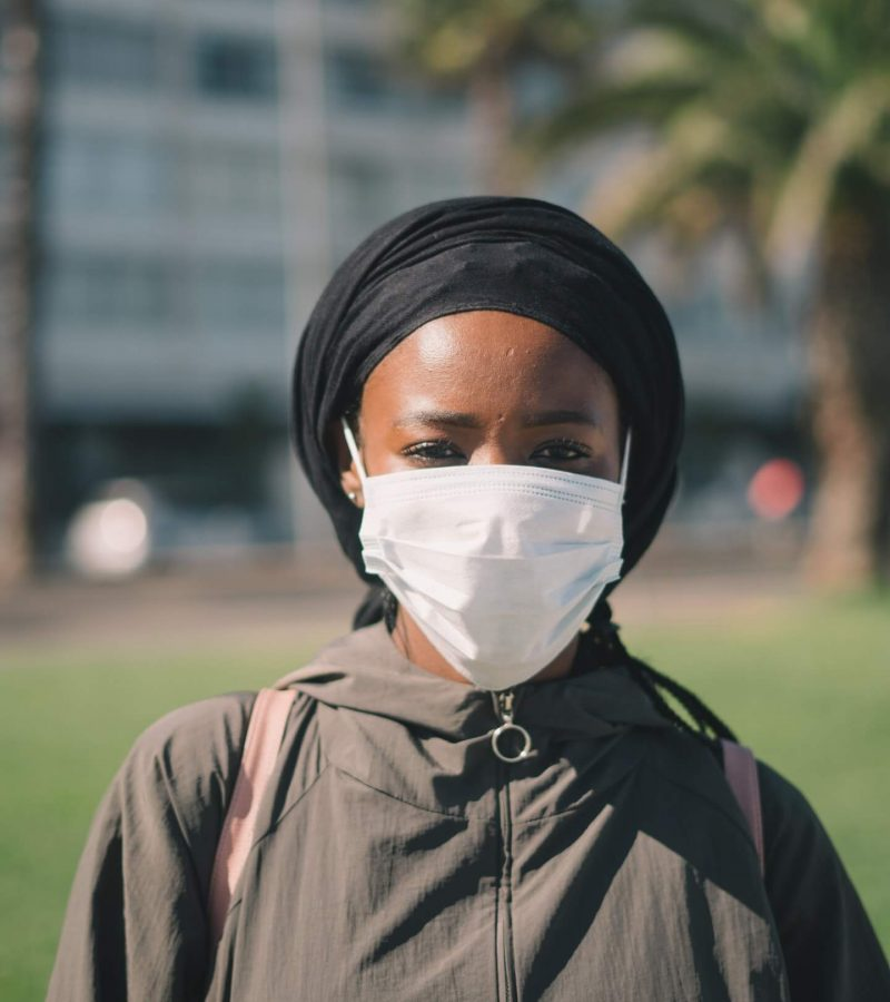 ethnic-woman-in-medical-mask-on-street-4177647